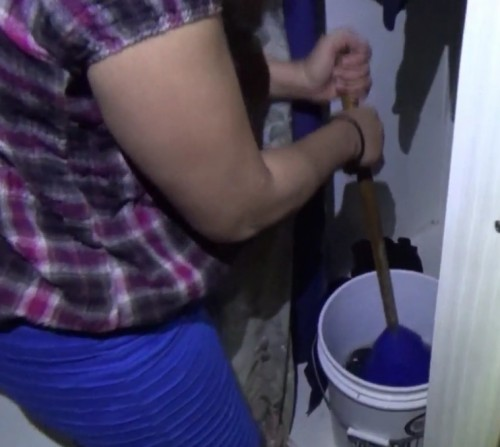 Off grid laundry washing with five gallon bucket and plunger