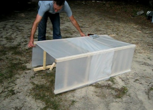 Covering the solar dehydrator frame with plastic
