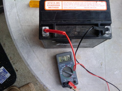Low voltage of a badly sulfated lawn mower battery
