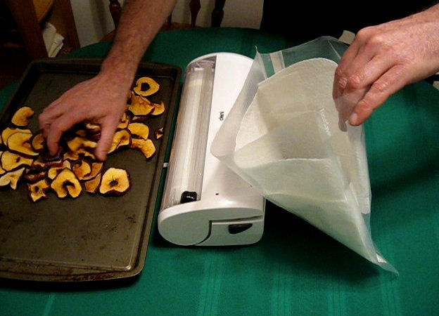 Line the vacuum sealer bag with paper towels